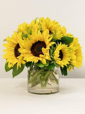 Vase of Smiling Sunflowers